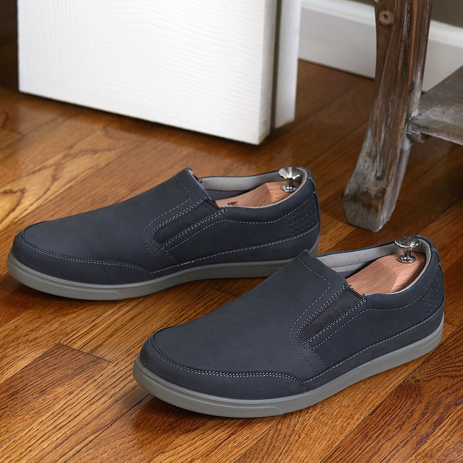 slip on sneakers with the shoe trees in them