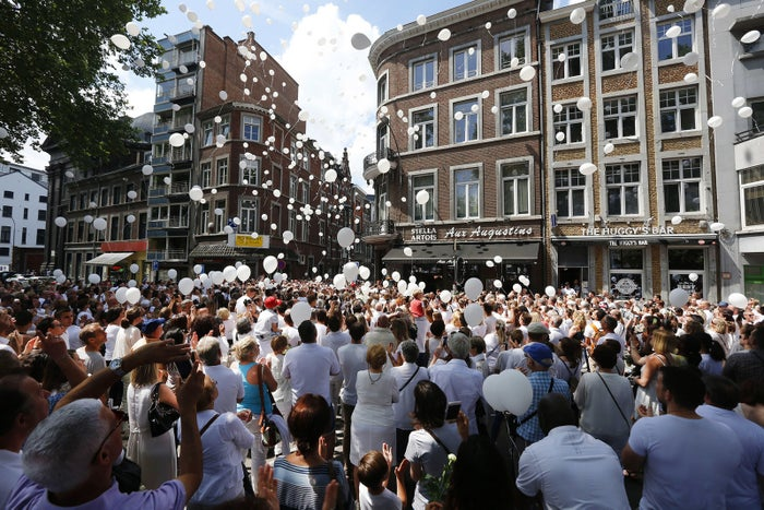 People take part in a white march on June 3 to commemorate the victims of a shooting that killed two police officers and a bystander on May 29, in Liège, Belgium.