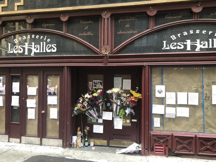 Tributes to Bourdain outside now-closed Les Halles in Manhattan on Friday