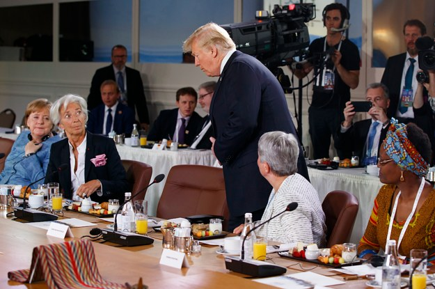 Trump Was Photographed Showing Up Late To A G7 Meeting On Women's Empowerment