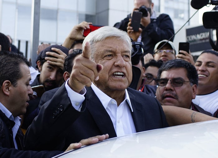 Andrés Manuel López Obrador talks to reporters as he departs after casting his ballot at a polling station during the presidential election in Mexico City, July 1.