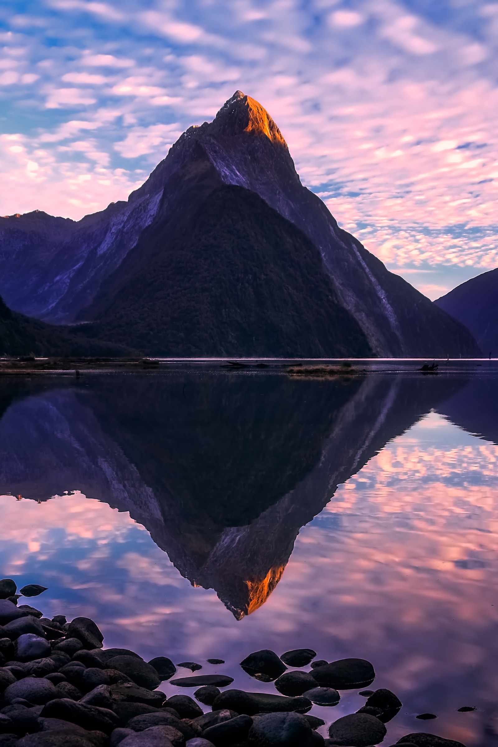 New Zealand: Fiordland National Park -  Head to New Zealand's South Island to visit this spectacular landscape, known for its deep fjords formed by glaciers and the tranquil Milford Sound.