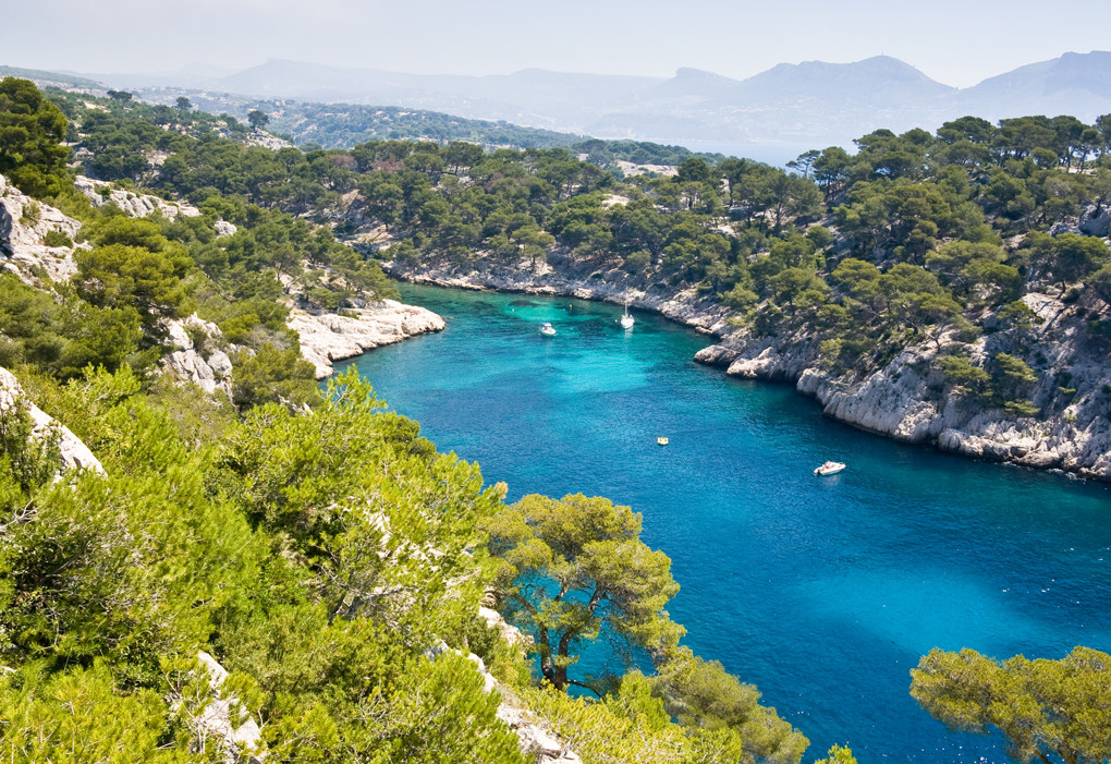 France: Calanques National Park -  Just a short trip from the city of Marseilles on France's southern coast, Calanques is a 20-mile stretch of limestone cliffs and azure seas. Cars are banned from the area all throughout the summer, making it the perfect time to visit and hike the scenic trails.