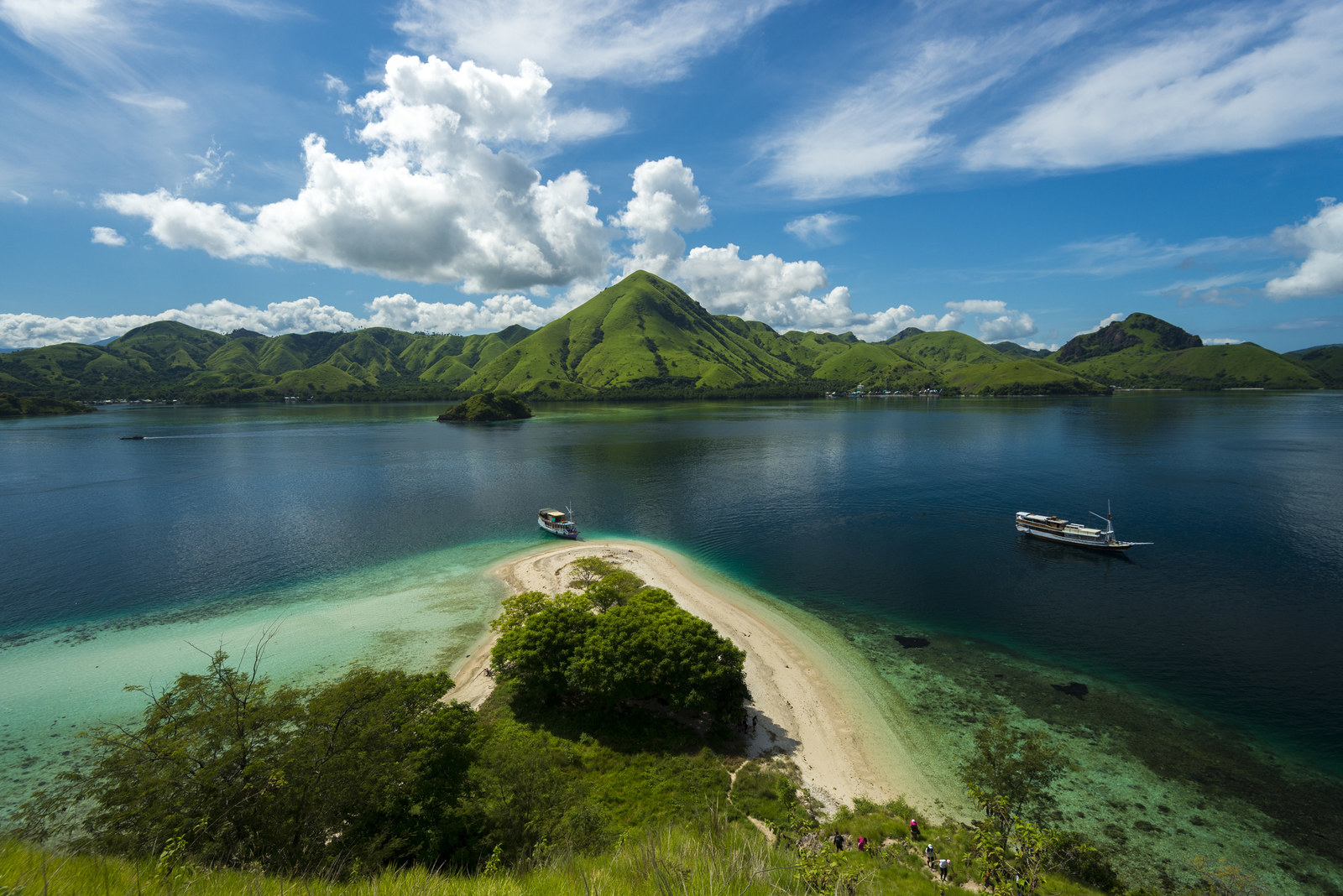 Indonesia: Komodo National Park -  This volcanic island may look tranquil, but it's actually inhabited by thousands of giant lizards (aka Komodo Dragons), which exist no where else in the world.