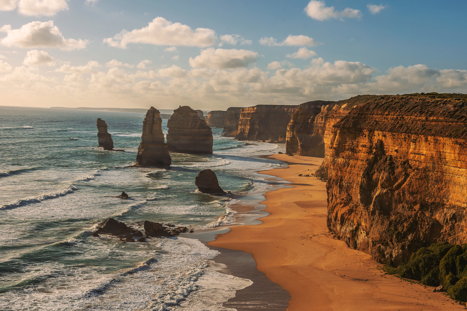 Australia: Port Campbell National Park -  The hallmark of this stretch of land in Victoria are The Twelve Apostles: a series of limestone stacks that jut out from the Southern (or Antarctic) Ocean.