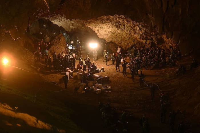 Thai soldiers relay electric cable deep into the Tham Luang cave at the Khun Nam Nang Non Forest Park in Chiang Rai on June 26