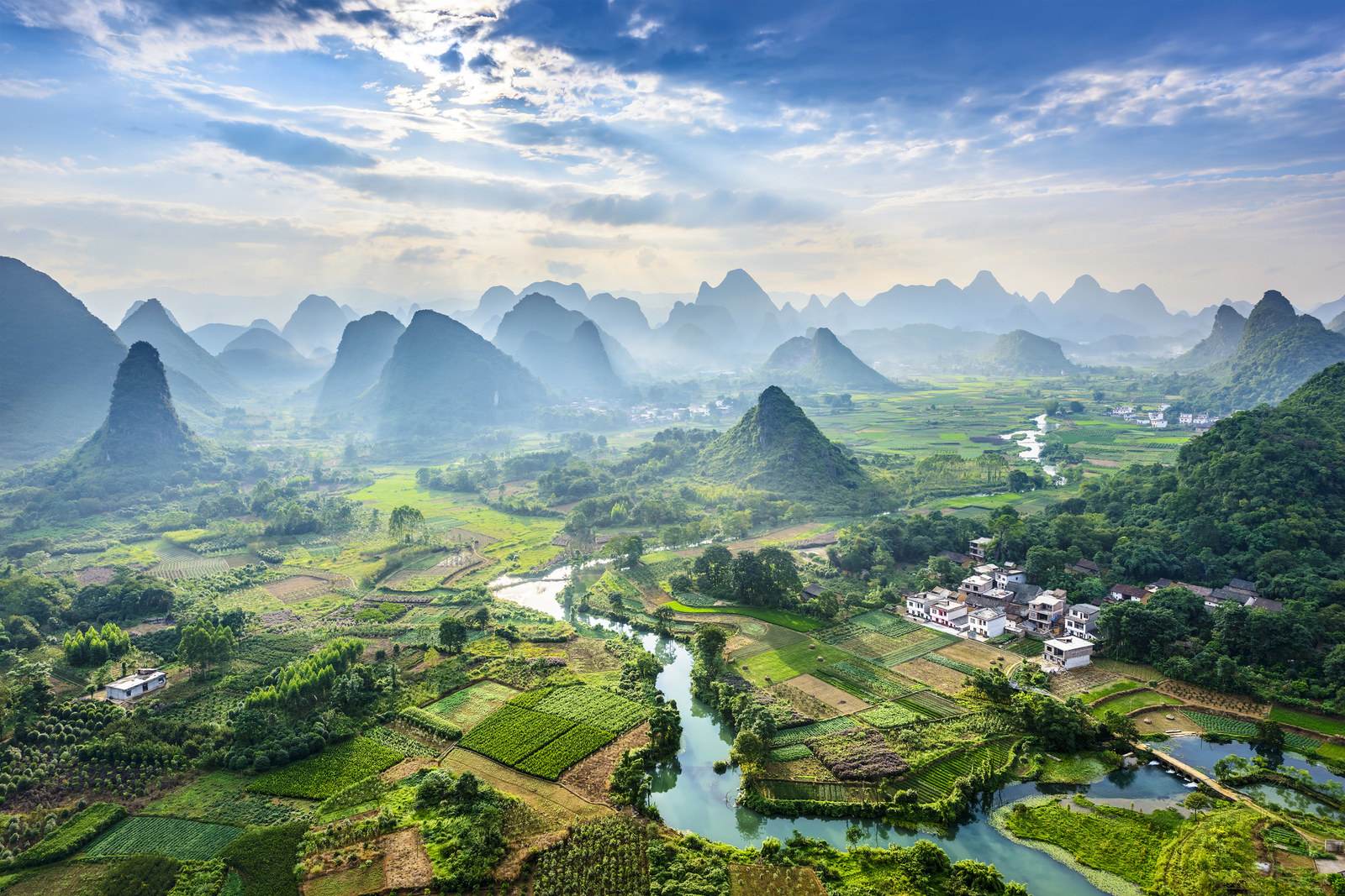 China: Guilin and Lijiang River National Park -  Set in southern China, the best way to see this unique setting made up of karst pillars, spiked cliffs, and dense forests is by river cruise.