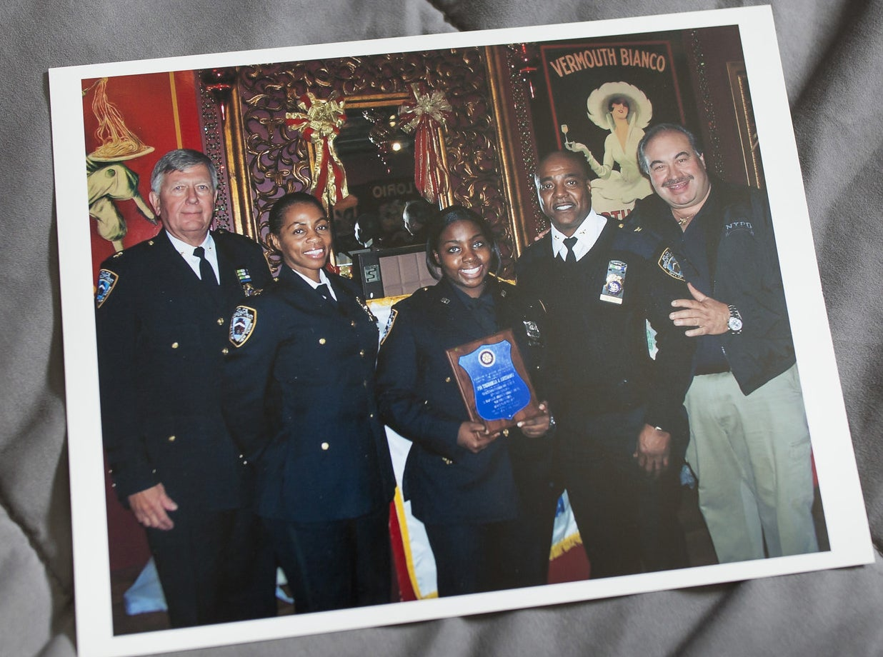 Inserillo (center), when she was named officer of the month.