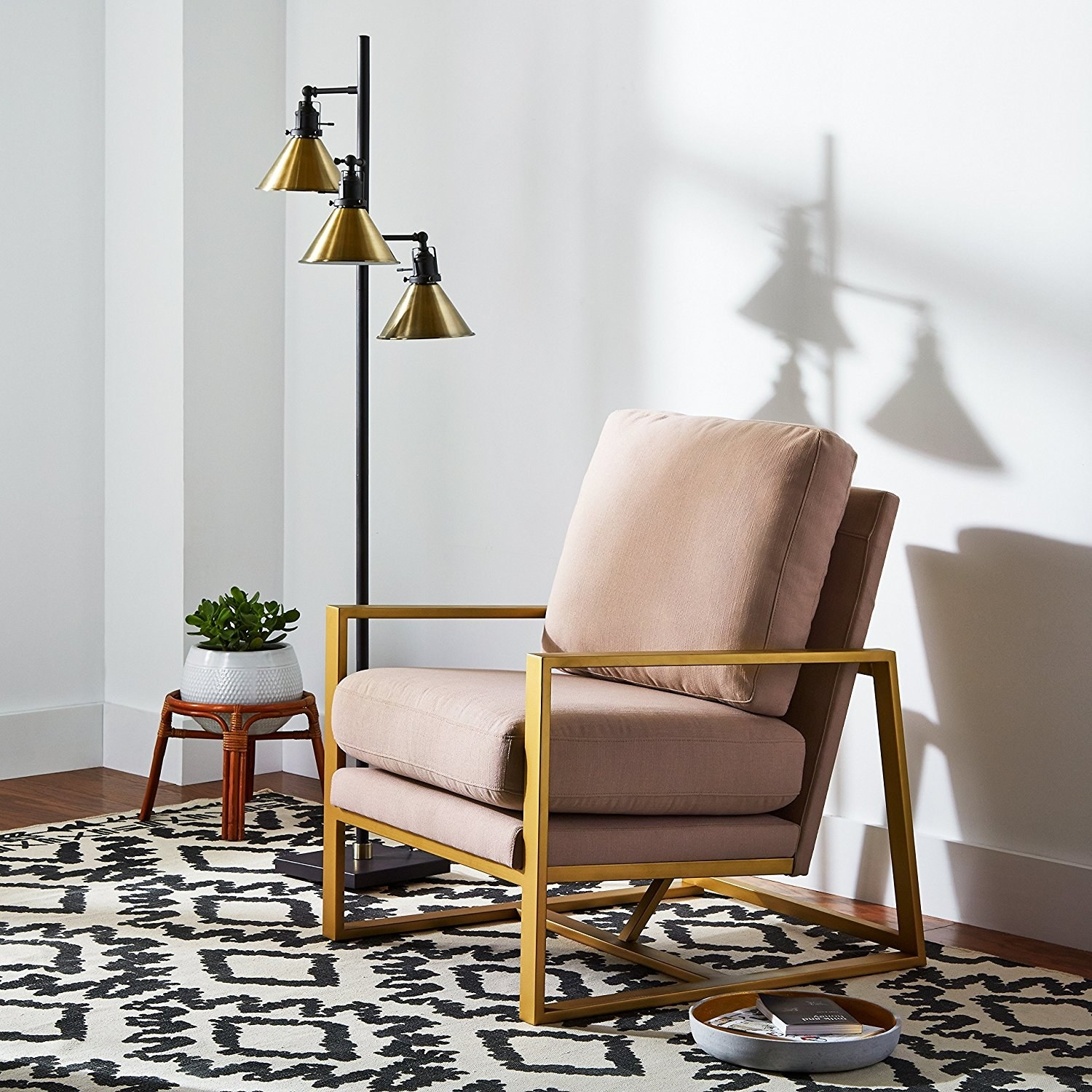 The Amazon Brand Rivet Charlotte mid-century modern upholstered gold accent chair in dusty rose.