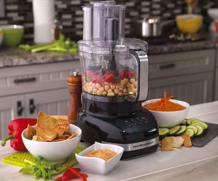 """Promising review: """"This is very useful, user friendly, and easy to store! My son decided he wanted to make a salad adding cucumbers, carrots, onion, and tomatoes — perfect opportunity to be the first to use our new processor. He put together a brilliant salad adding perfectly sliced cucumbers, small diced carrots, onions, and tomatoes (which were diced instead of mush)! He even shredded Gouda cheese to top the salad. This is a very nice processor. The small bowl is terrific for smaller needs like chopped walnuts or chocolate pieces. My money was well spent."""" —RanDelkPrice: $51.99"""