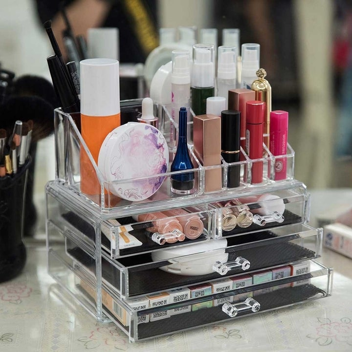 clear organizer with two small drawers and two large drawers holding makeup