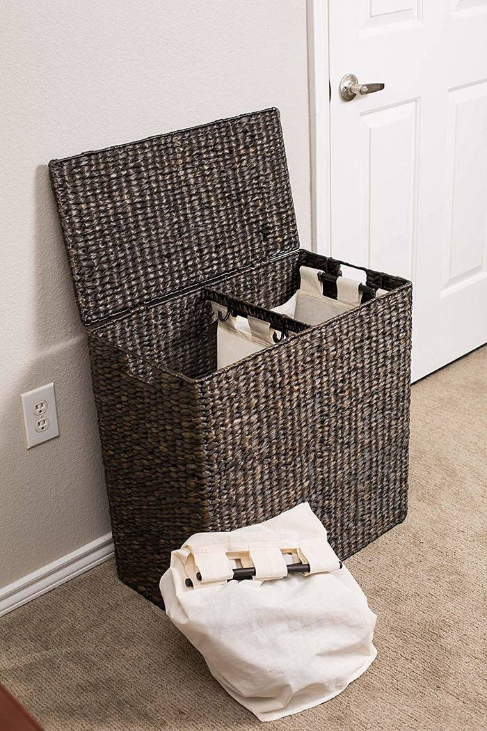 """Promising review: """"Makes laundry easy and looks really nice. Trust the other reviewers, it is really inconspicuous. It looks like a piece of furniture, not a hamper."""" —Ajai J.Price: $94.74 (available in two colors)"""