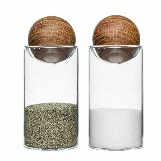"""Promising review: """"Love these salt and pepper shakers! They are simple, classy, and people love them on the table. For those that said the balls fall off easily, mine don't. But they might not be the best shakers if you have small kids because they look like they are so fun to play with!"""" —SparrowGet the set from Amazon for $20."""