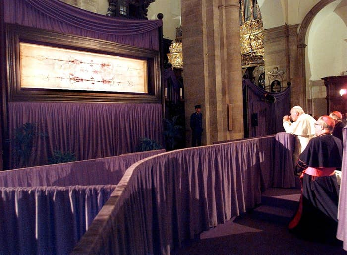Pope John Paul II prays at the Turin Cathedral of St. John the Baptist before the controversial Turin shroud.