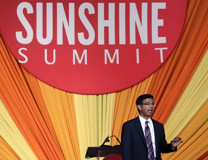 Dinesh D'Souza addresses the audience at the Republican Sunshine Summit, Friday, June 29, 2018, in Kissimmee, Florida.