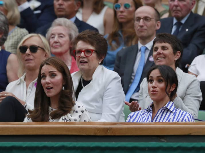 Yes, that is tennis legends Martina Navratilova and Billie Jean King (in the red glasses) behind them.