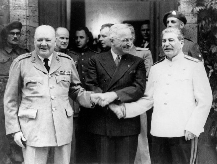 From left: British Prime Minster Winston Churchill, President Harry Truman, and Stalin shake hands during the Potsdam Conference in July 1945.