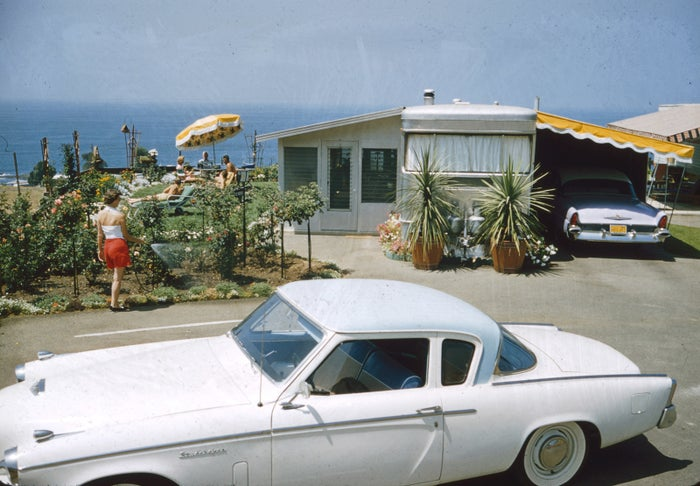 A Studebaker is parked in front of a trailer in Laguna Hills Park in 1956.