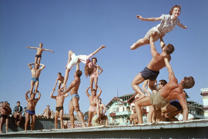 A group of bodybuilders pose in gymnastic formations at Muscle Beach, Santa Monica, in 1956.