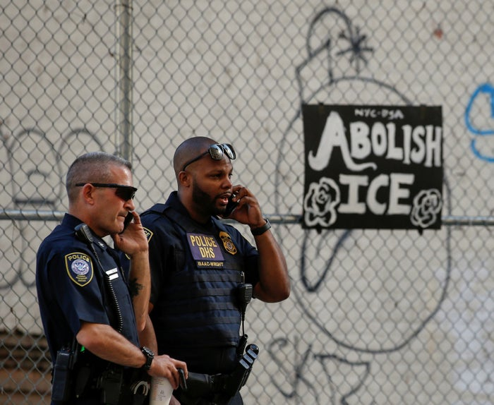 Department of Homeland Security officers watch members of Occupy ICE outside the ICE offices in New York City.