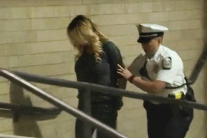 In this video frame, Stormy Daniels is led into jail in Columbus, Ohio, on July 11.
