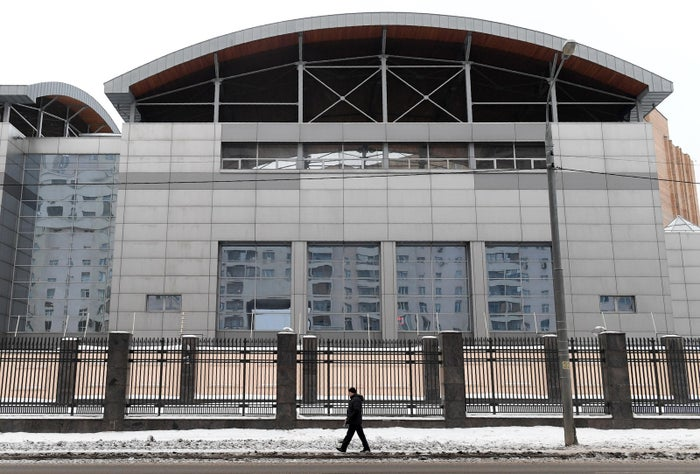 A man walks past the building of the headquarters of the Russian General Staff's Main Intelligence Directorate (GRU) in Moscow on Dec. 30, 2016.