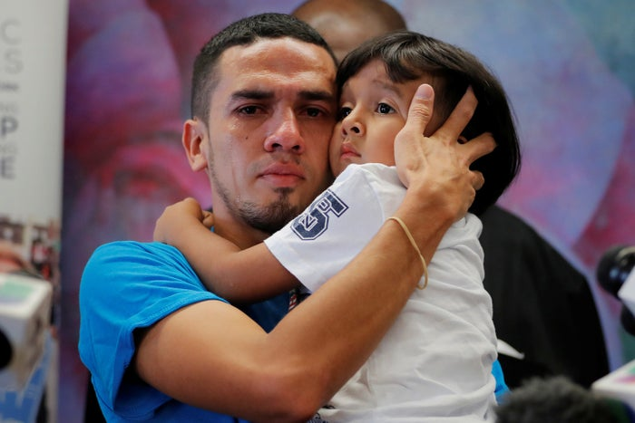 Javier, 30, from Honduras, holds his 4-year-old son William in New York after they were reunited after being separated for 55 days following their detention at the Texas border July 11.