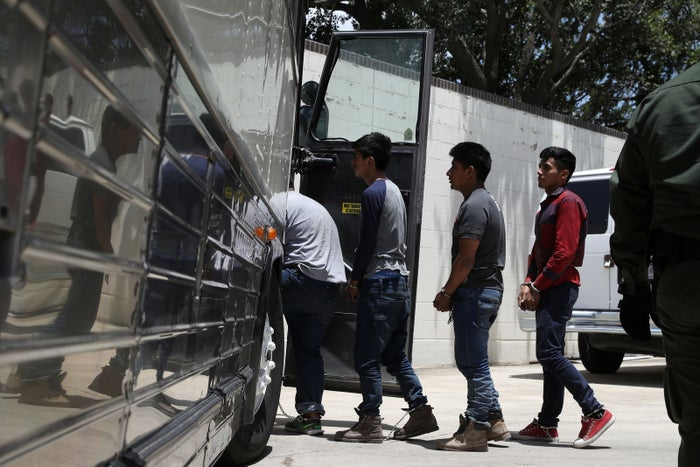 Undocumented immigrants board a bus before departing federal court following hearings in McAllen, Texas, on July 3.