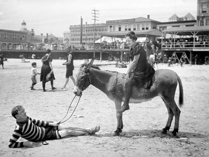 A woman rides a donkey on the beach in Atlantic City in 1901.