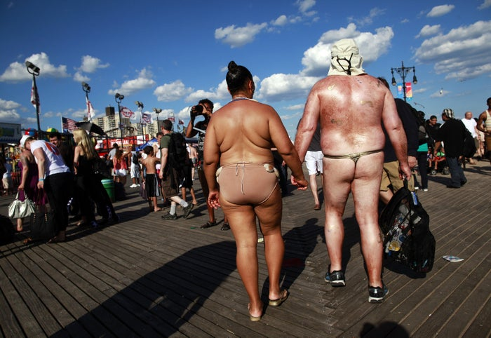 People participate in the Coney Island Mermaid Parade in Brooklyn, New York, on June 23, 2012.