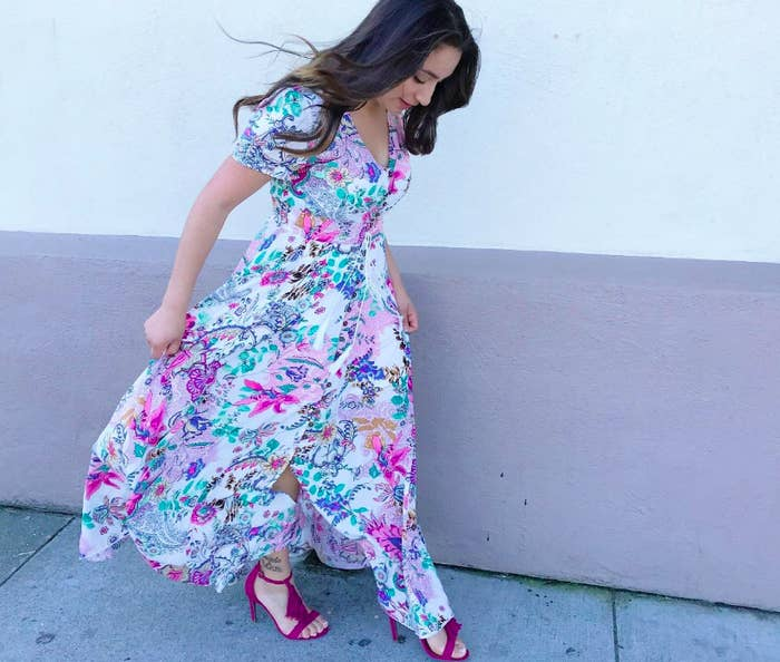 dc98b7db51 A gorgeous flowing floral-print dress that buttons all the way up.