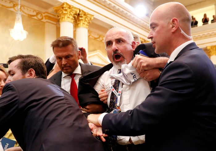 Security personnel removes a man from the premises before Trump and Putin hold a joint news conference on July 16.