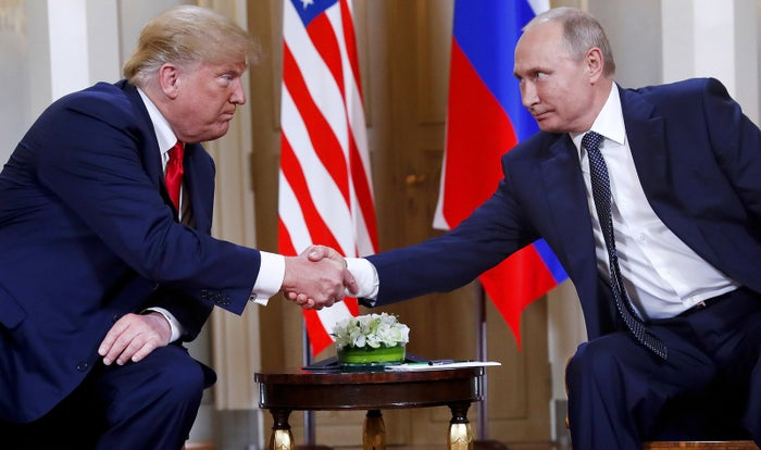 President Donald Trump and Russian President Vladimir Putin shake hands at the beginning of a meeting at the Presidential Palace in Helsinki, Finland, on July 16.