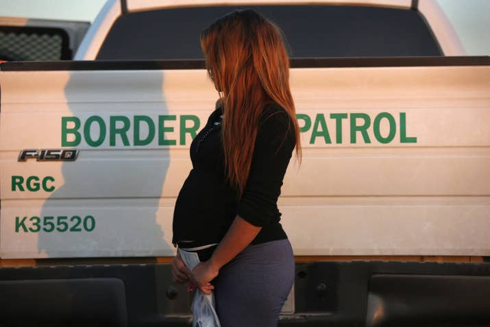 A pregnant immigrant from El Salvador — who is not E. — next to a Border Patrol truck after turning herself in Dec. 7, 2015.