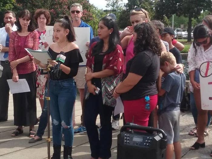 Maria (center) and several immigration advocates at a rally Friday.
