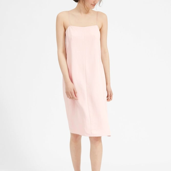 """Promising review: """"Love this dress. It fits true to size and is perfect for this hot summer we have going on here in NYC. Also, super easy to wear casually or dress it up for something more formal."""" —NYCizGet it from Everlane for $88 (available in sizes 00-14, and in pink and yellow)."""