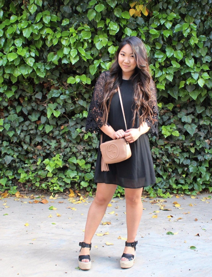 reviewer wears midi dress with lacy wide quarter sleeves