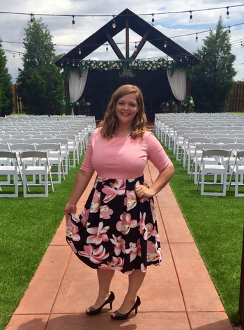 reviewer wears the dress in pink