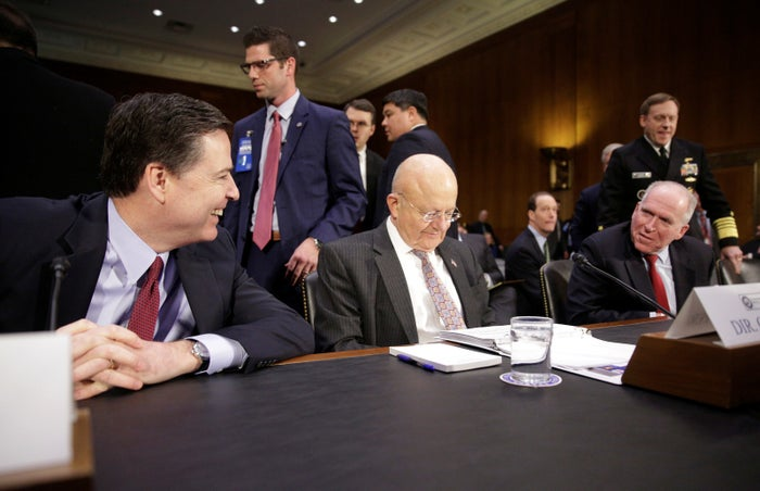 Former FBI director James Comey, former director of national intelligence James Clapper, and former CIA director John Brennan at a Senate hearing in January 2017.