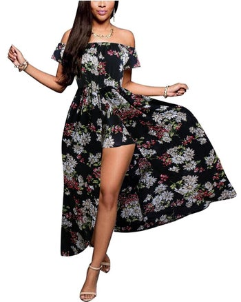 model wears off the shoulder dress with shorts under the slitted skirt