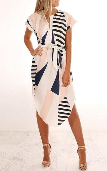 model wears short sleeve dress with geometric shapes on it