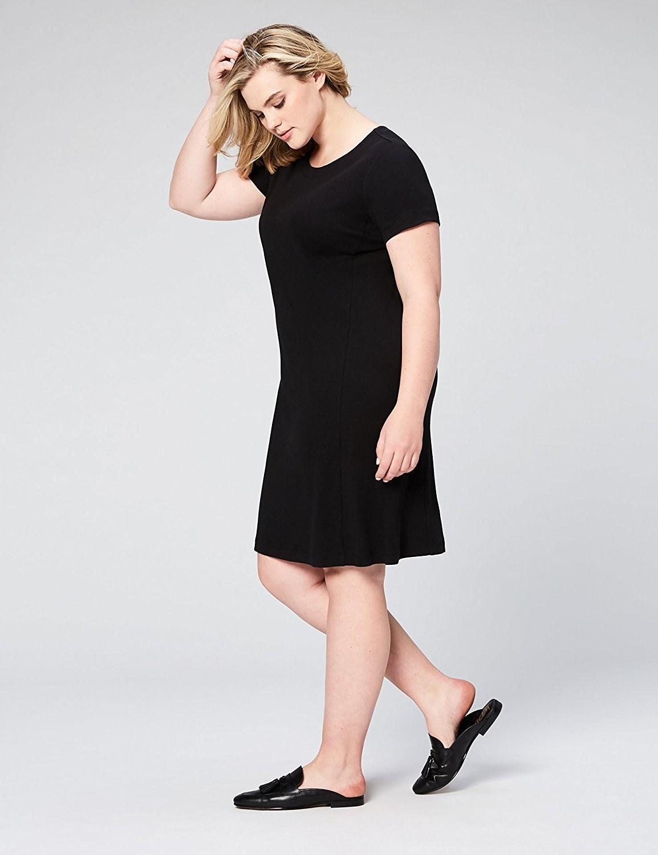 model wears loose midi dress in black
