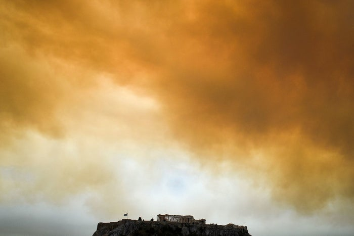 The sky over the Parthenon temple turned orange with smoke on Monday.