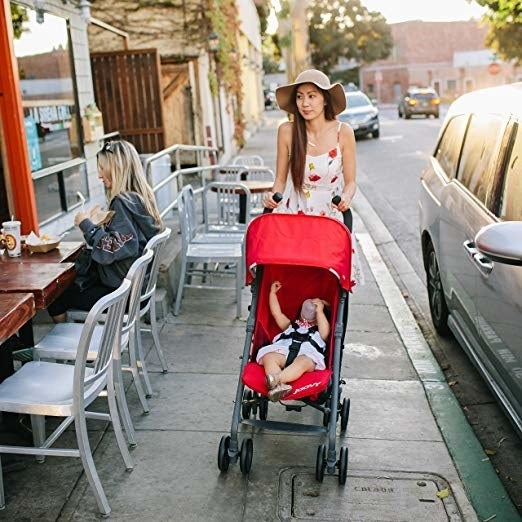 """This stroller carries newborns to kids up to 55 lbs. It also provides sun protection with a UPF 50 canopy and an almost flat recline, which is perfect for nap time. Promising review: """"We first bought a different stroller but ended up returning it because my husband and I were constantly hunched over and ended up getting backaches from it (I'm 5'7"""" and he's 6'1""""). The handle just wasn't high enough for us. Also our 3-year-old is pretty tall for his age and the seat was just too small for him. So, I did my research and the JOOVY has actually been recommended as the stroller to get for tall people or just simply anyone who feels that the other lightweight strollers out there just don't have a high enough handle. Using it is so much more comfortable for my husband and I, and my son enjoys sitting in it much more."""" —Amazon CustomerPrice: $115.51+ (available in four colors)"""