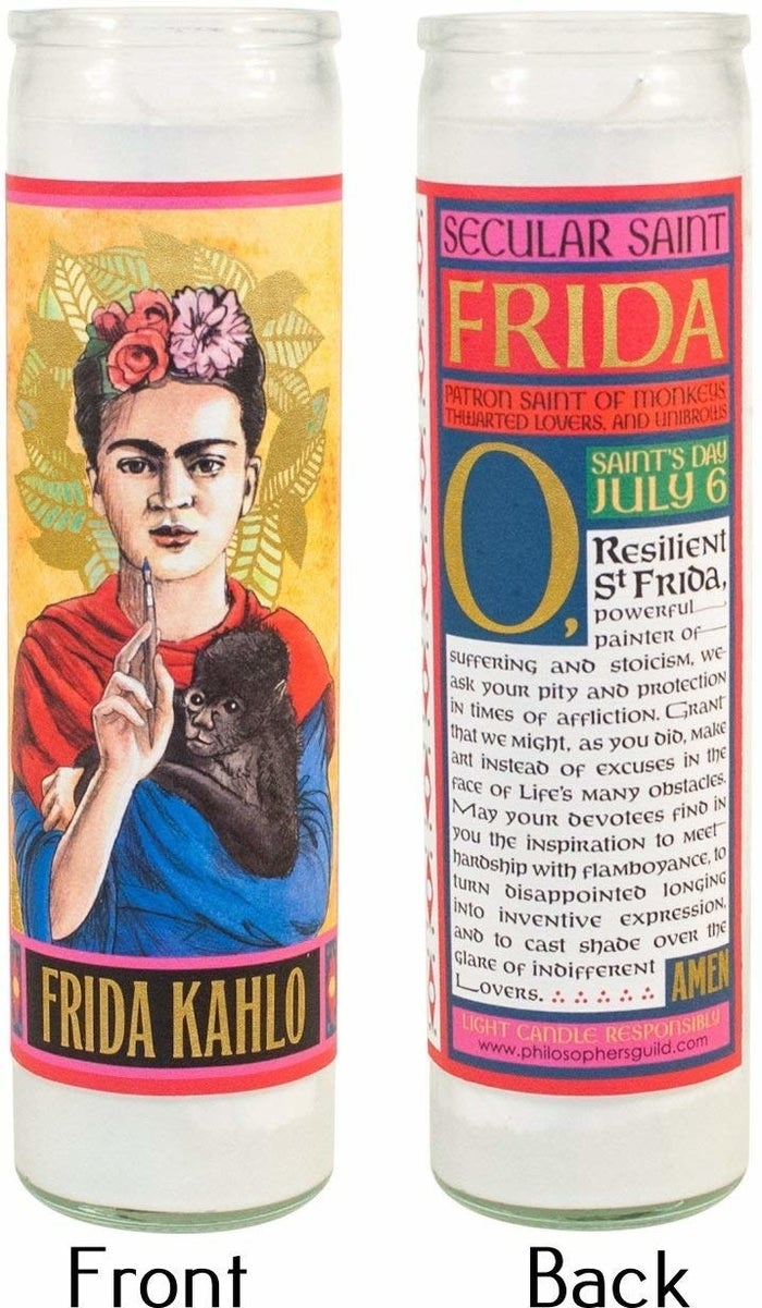 """Promising review: """"Adorable. As a Catholic, I take my candles seriously. I light it while I'm making art. Frida is an icon and hero for me, she overcame insurmountable pain and painted her emotions. So I light it and say a prayer, even the words written on it. It lights well and stays lit, but like all candles, I would not leave it unattended. I LOVE this candle."""" —HYPNOJADEPrice: $12.95 (choose from 20 different """"saints"""")"""