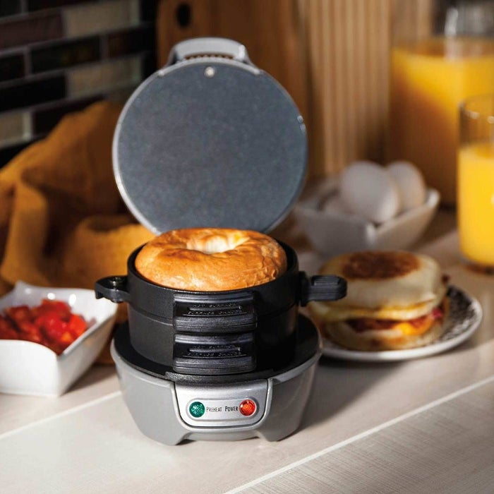"""The cooking surfaces are non-stick and the removable parts are dishwasher-safe.Promising review: """"Nice little breakfast sandwich maker. I am still experimenting with it. Cooks fast so I need to cut down on the suggested cooking time in order to get the egg and muffin the way I like it. Clean up is easy. Spraying the plates lightly with cooking spray makes it easier to clean. It beats spending money at McDonald's or other fast food places. You can customize your breakfast sandwich with bagels, croissants, biscuits, different meats, and cheeses, etc."""" —doowop47Get it from Walmart or Jet for $24.99."""