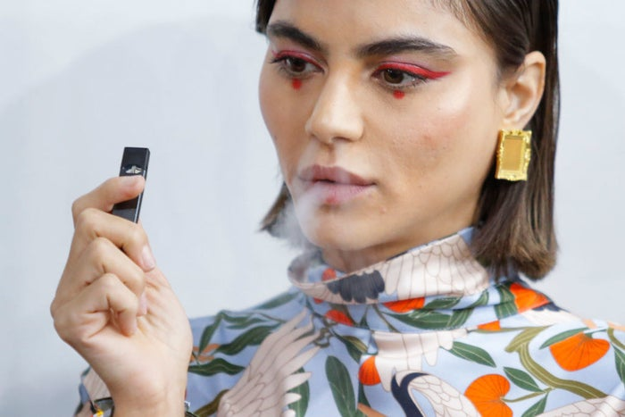 A model smokes a Juul before a show at 2018 New York Fashion Week.