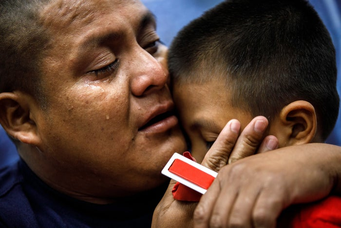 Guatemalan asylum-seeker Hermelindo Che Coc cries as he reunites with his 6-year-old son, Jefferson Che Pop, in the Los Angeles area on July 14. The father and son were separated at the US–Mexico border and were apart for nearly two months.