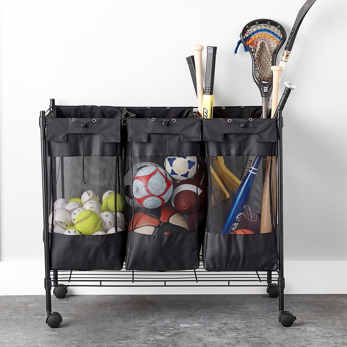 black rolling organizer with three mesh compartments containing sports balls and equipment