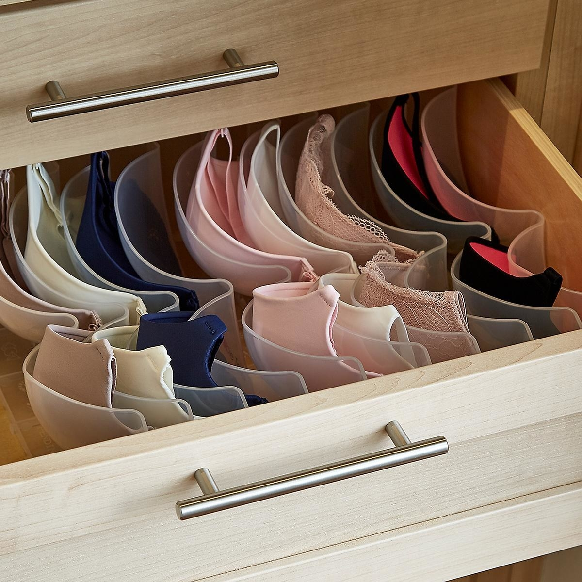 open drawer with cup-shaped bra organizer in the drawer